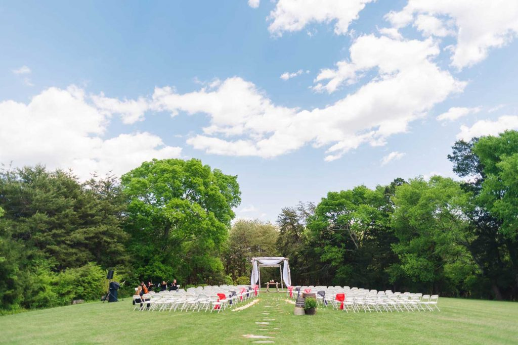 outdoor wedding ceremony area behind the barn at drewia hill in Sale Creek TN