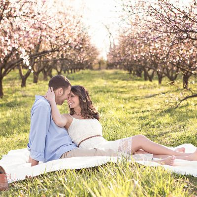 engaged couple in the peach orchard behind the barn at drewia hill