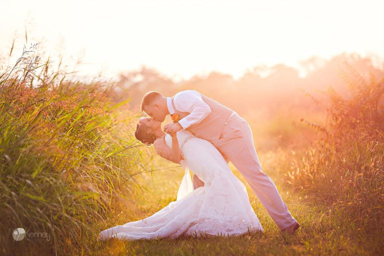 wedding couple at sunset in open field at the barn at Drewia hill