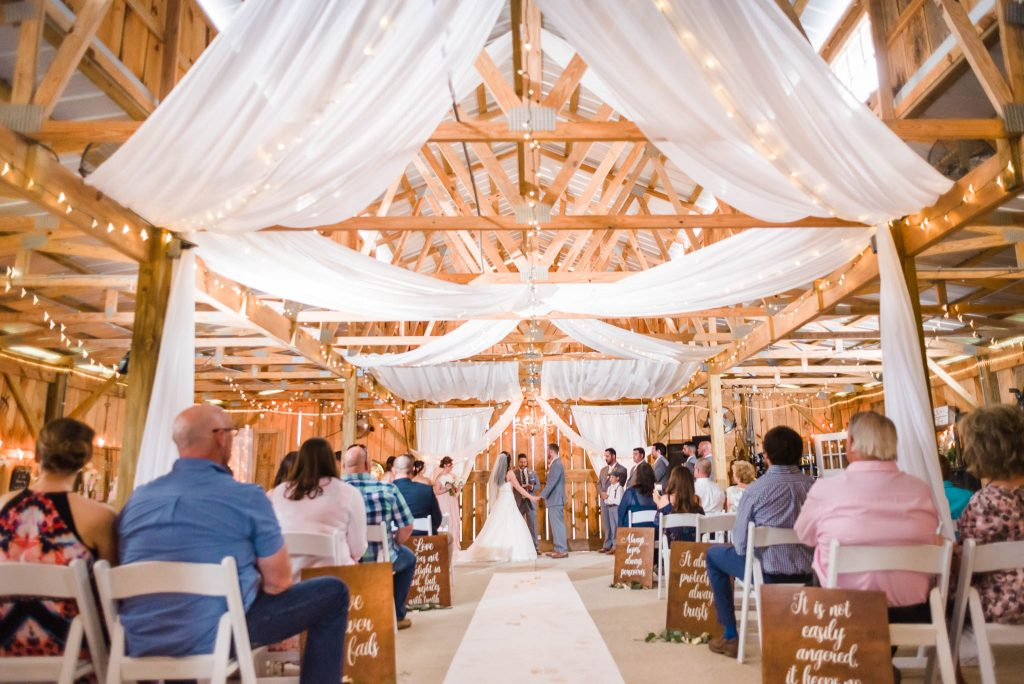 Indoor wedding ceremony on rainy day at the barn at drewia hill near Chattanooga tn