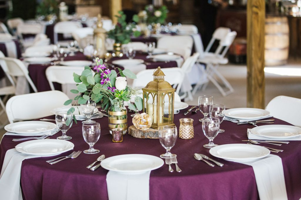 wedding reception in plum colored table cloths