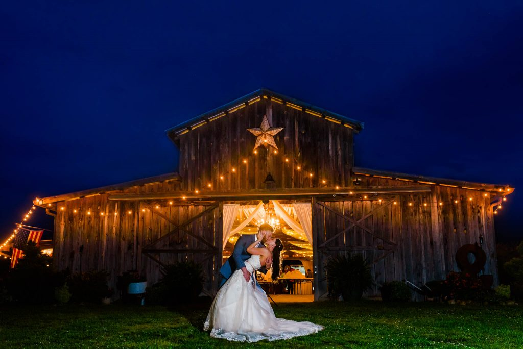 Nelya_ weding couple in front of The Barn at Drewia hill at night on their wedding day