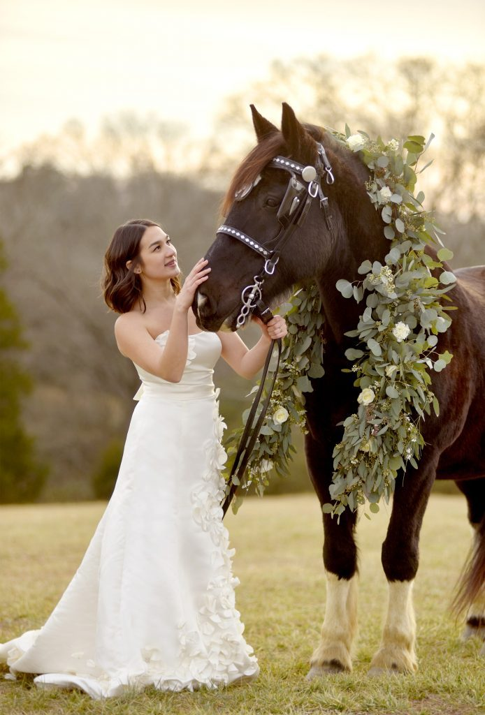 Bride with a horse and floral and greenery wreath by Kathleen Greeson for Chattanooga Carriage Company.
