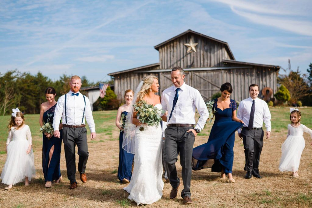 fall wedding party in front of the Barn at Drewia hill in Sale Creek TN